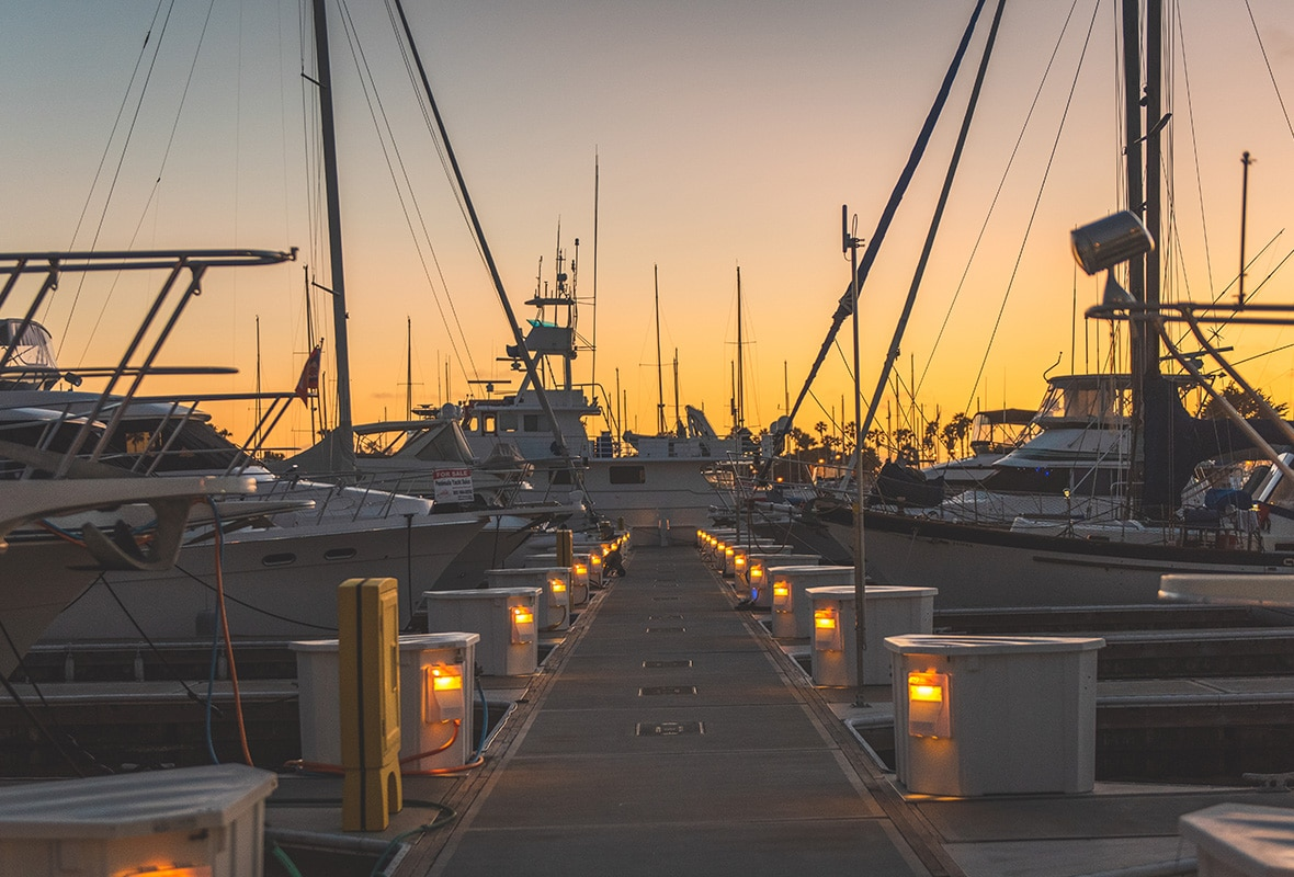 Boats docked at sunset