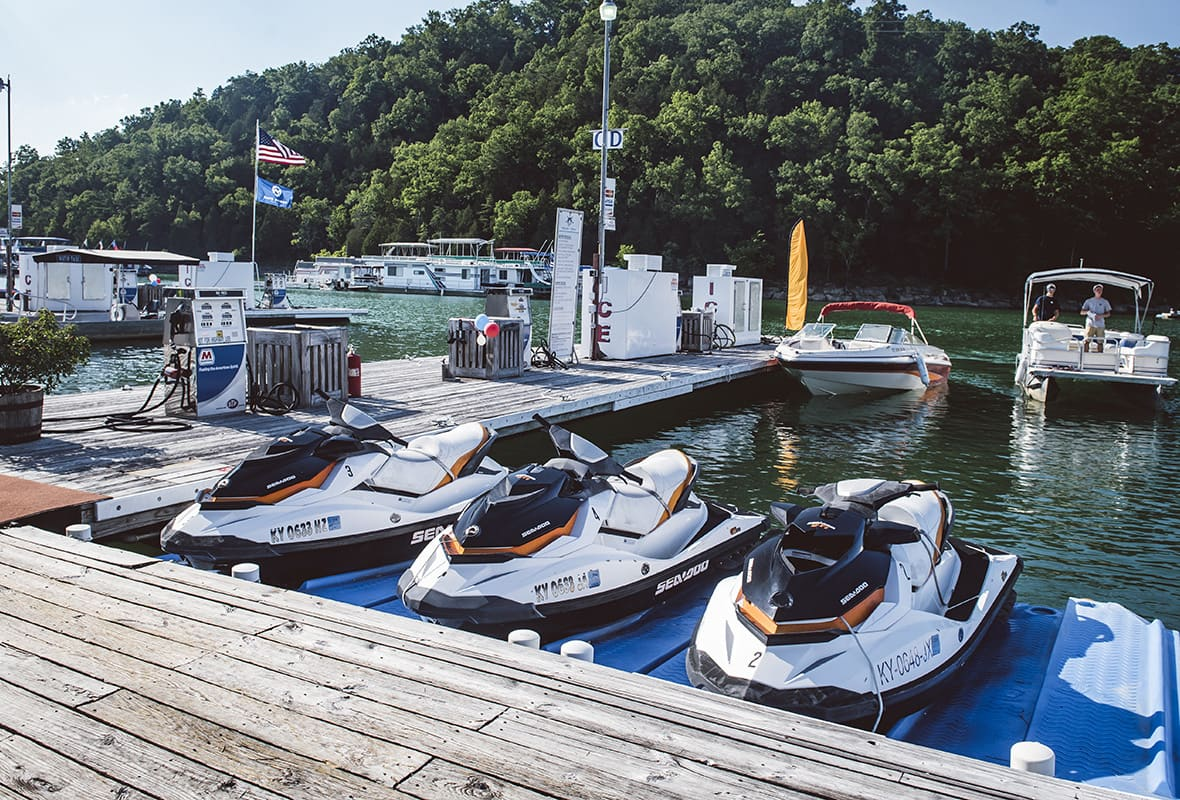 Jet skis docked at marina