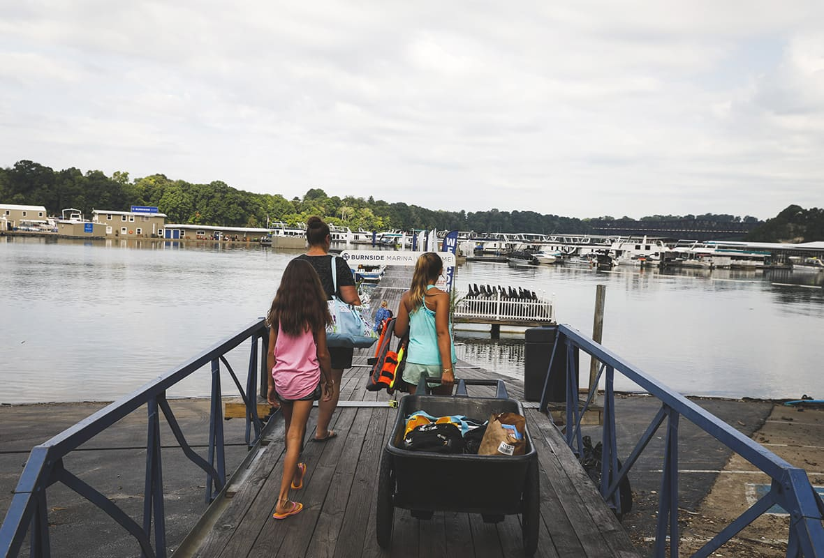 Mom and daughters going to load their boat