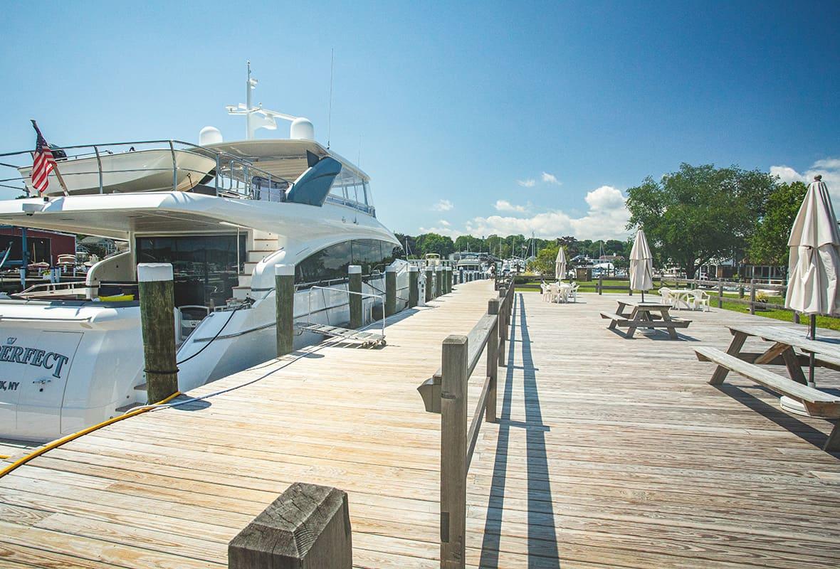 Picnic table and boats at dock