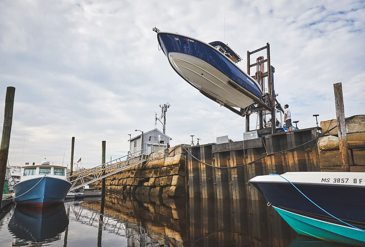 Boat being lifted down to water