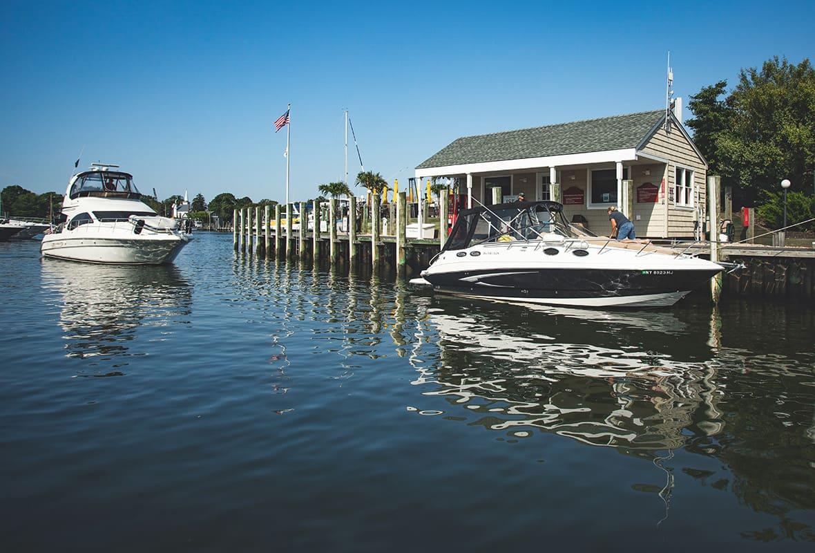 Boats docking at marina