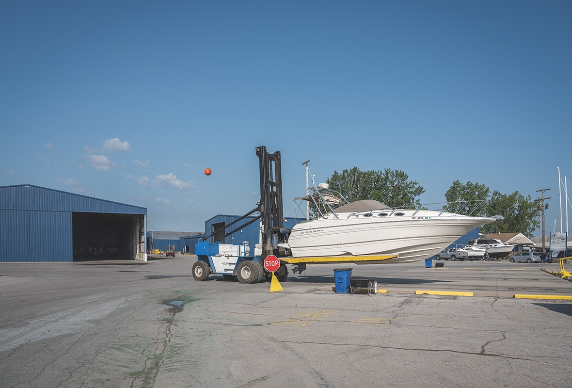 Boat being lifted from storage