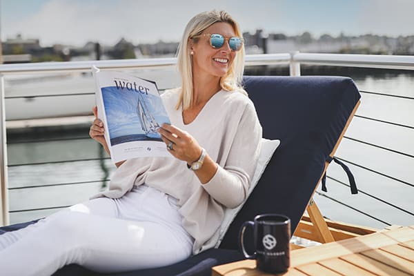 Woman reading Safe Harbor Water Magazine