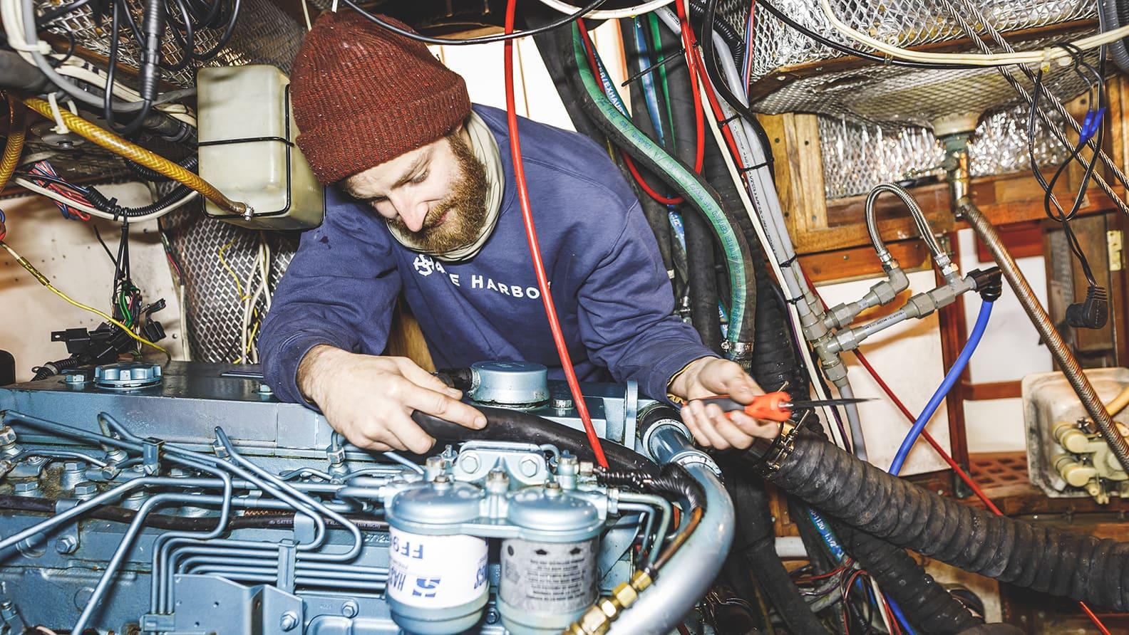 man fixing boat